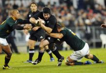 New Zealand All Blacks Andrew Hore pushes through the South African Springboks. Pic :NZPA