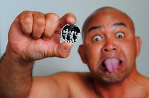 Tiki Edwards, Maori Development Manager for the NZRU, showcases the new Haka coin.