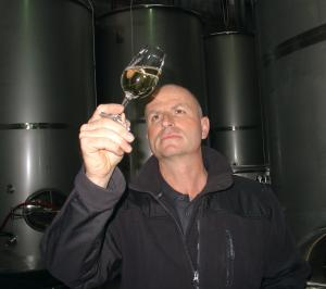 Daniel Schwarzenbach checks the 2011 vintage of their vegan wine.