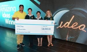 Piri Weepu presenting a cheque to Lucy Douglas, Noor Al-Shamma and Tyler Davidson on behalf of Katikati College.