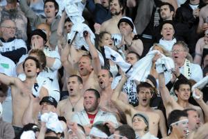 """""""White noise"""" supporters get behind the New Zealand All Whites soccer team. Pic: NZPA"""